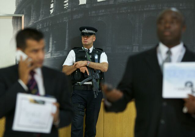 An armed British policeman secures terminal 4 at Heathrow airport, London.