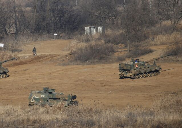 South Korean mobile artillery vehicles are seen at a training field near the demilitarized zone separating the two Koreas in Paju, South Korea, January 7, 2016