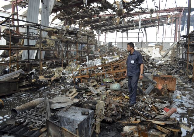 A worker stands at a beverages factory after it was hit by a Saudi-led air strike in Yemen's Red Sea port city of Houdieda January 6, 2016.