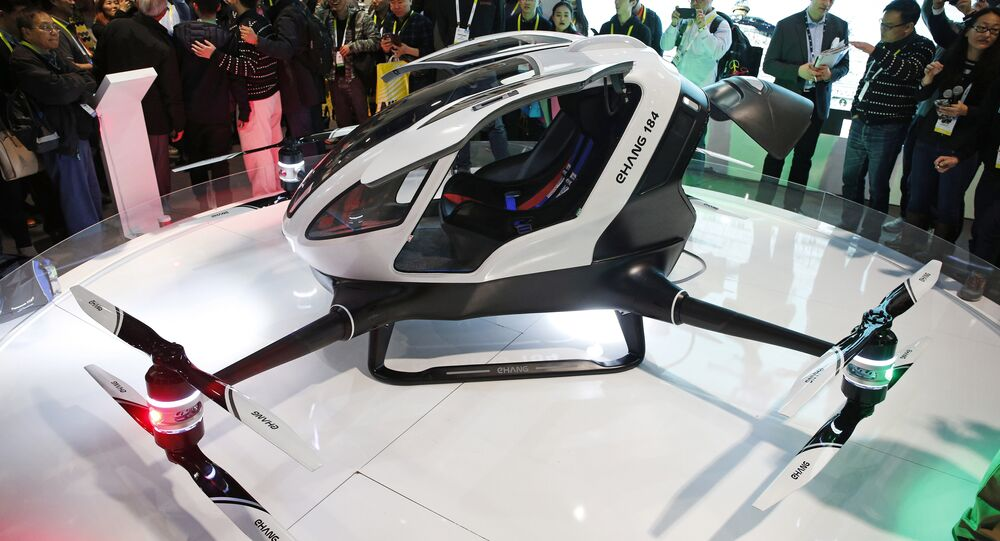 The EHang 184 autonomous aerial vehicle is unveiled at the EHang booth at CES International, Wednesday, Jan. 6, 2016, in Las Vegas.