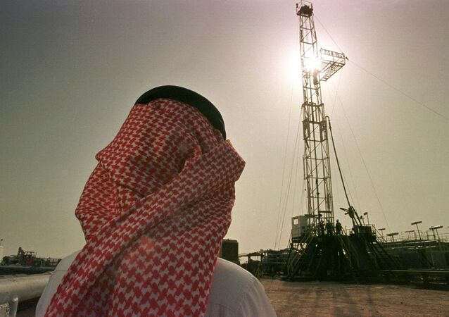 Khaled al Otaiby, an official from the Saudi oil company Aramco, watches progress at a rig at the al-Howta oil field.