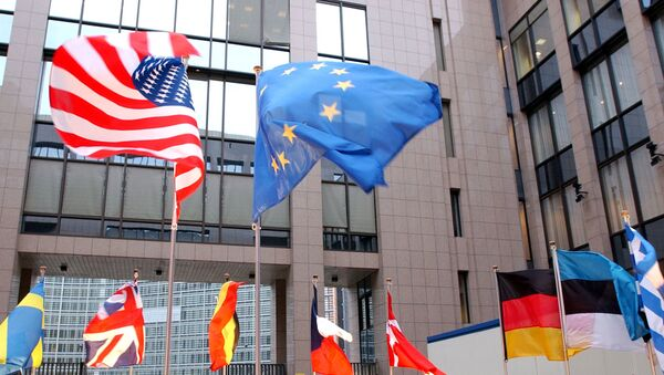 The US and EU flags, top left and right, fly in separate directions at the European Council building in Brussels - Sputnik International
