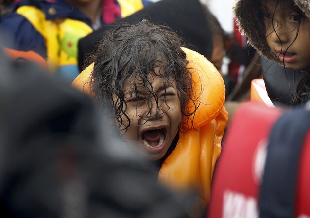A Syrian refugee child screams inside an overcrowded dinghy after crossing part of the Aegean Sea from Turkey to the Greek island of Lesbos September 23, 2015.