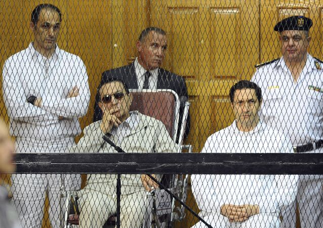 FILE - In this Sept. 14, 2013 file photo, former Egyptian President Hosni Mubarak, seated center left, and his two sons, Gamal Mubarak, left, and Alaa Mubarak attend a hearing in a courtroom in Cairo, Egypt