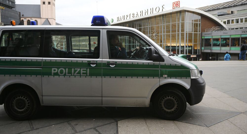 A police vehicle patrols at the main square and in front of the central railway station in Cologne, Germany, January 5, 2016