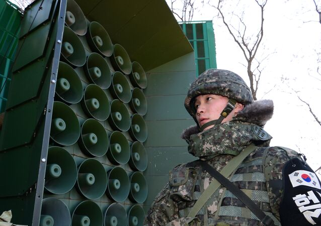 South Korean soldier stands guard in front of loudspeakers as the military prepares propaganda broadcasts near the border area between South Korea and North Korea in Yeoncheon, northeast of Seoul, on January 8, 2016