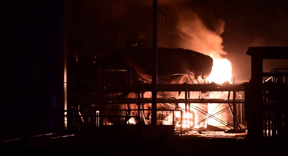 In this photo released by China's Xinhua News Agency, a chemical plant of Shandong Runxing Chemical Technology Co. is on fire following an explosion in Zibo, east China's Shandong Province, Sunday, Aug. 23, 2015