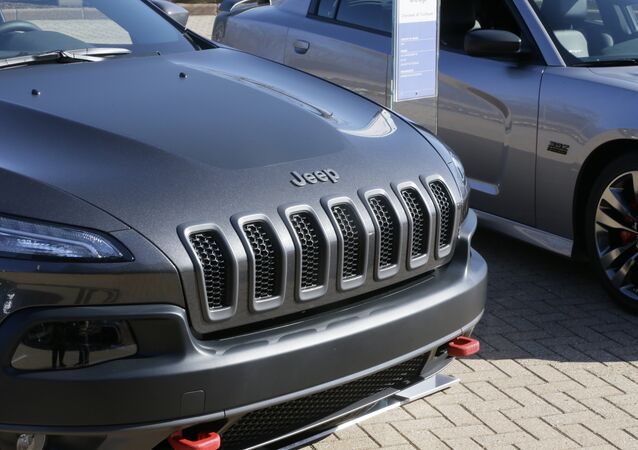 A Jeep Cherokee Trailhawk is displayed with Chrysler and Fiat vehicles at Chrysler Group LLC world headquarters in Auburn Hills, Mich., Tuesday, May 6, 2014