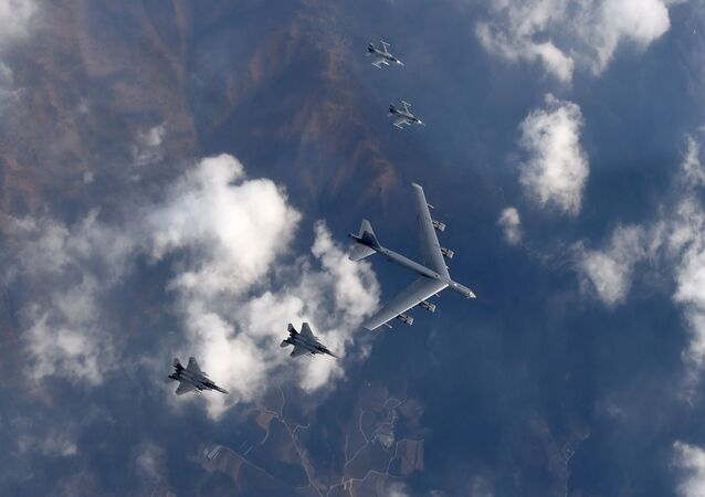 This picture taken by the Republic of Korea Air Force on January 10, 2016 and released via Yonhap news agency shows a US B-52 Stratofortress (C) flying with South Korean F-15K fighter jets (bottom) and US F-16 fighter jets (top) over South Korea