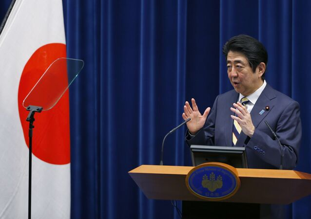 Japanese Prime Minister Shinzo Abe delivers a speech during a new year's press conference at his official residence in Tokyo, Monday, Jan. 4, 2016