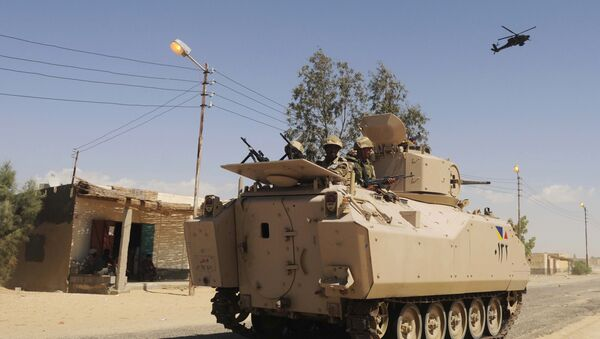 File photo, Egyptian Army soldiers patrol in an armored vehicle backed by a helicopter gunship during a sweep through villages in Sheikh Zuweyid, north Sinai, Egypt - Sputnik International