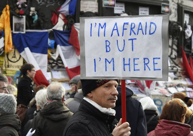 A man holding a placard reading I am afraid but I am here during a gathering on Place de la Republique (Republic square) on January 10, 2016 in Paris, as the city marks a year since 1.6 million people thronged the French capital in a show of unity after attacks on the Charlie Hebdo newspaper and a Jewish supermarket