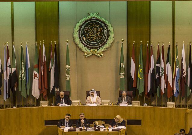 Emirati Foreign Minister Sheikh Abdullah bin Zayed al-Nahyan (C), Arab League chief Nabil al-Arabi (L), and Arab League deputy Ahmed bin Helli (R) attend an emergency meeting of Arab foreign ministers in the Egyptian capital Cairo on January 10, 2016