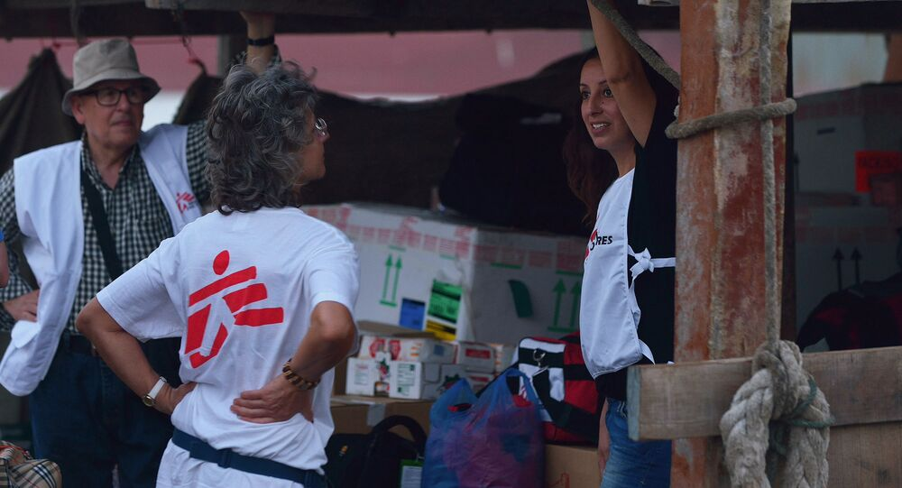 Medical experts, including members of Doctors Without Borders (MSF), stand on deck a boat commissioned by MSF to deliver surgical and other medical kit across the Gulf of Aden to Yemen on April 14, 2015