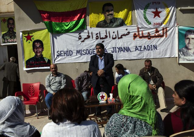 Salih Muslim, head of the Democratic Union Party (PYD) receives condolences from Kurdish people after his son Servan was killed allegedly by a Jabhat al-Nusra sniper several days ago on October 15, 2013.