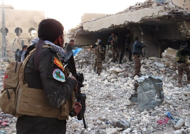 Iraqi forces secure an area in Ramadi, the capital of Iraq's Anbar province, on January 10, 2016, after retaking the city from Islamic State (IS) group jihadists