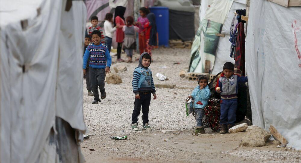 Syrian children are seen inside an informal settlement for Syrian refugees in Bar Elias, Bekaa valley, Lebanon, January 6, 2016