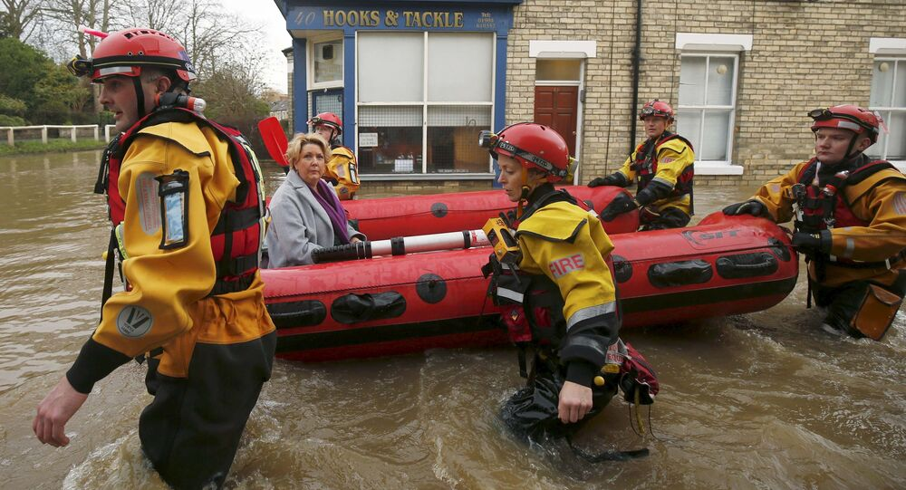 Members of emergency services rescue a woman from a flooded house in York after the river Ouse burst its banks, in northern England, in this December 28, 2015 file photo