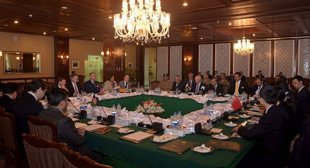 In this photo released by Associated Press of Pakistan, delegates from Pakistan, Afghanistan, China and United States attend a meeting hoping to lay the roadmap for peace talks with the Taliban, at the foreign ministry in Islamabad, Pakistan, Monday, Jan. 11, 2016