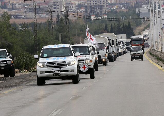 Aid convoys carrying food, medicine and blankets, leave the Syrian capital Damascus as they head to the besieged town of Madaya on January 11, 2015