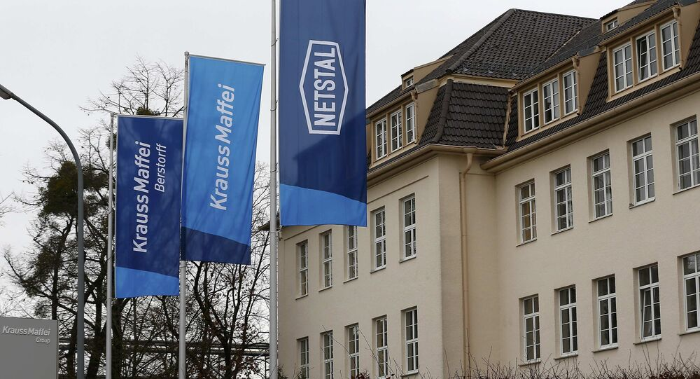 Flags flutter in front of a KraussMaffei company building in Munich, Germany, January 11, 2016