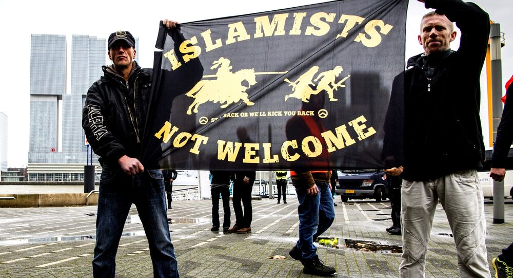 Supporters of Pegida (Patriotic Europeans Against the Islamisation of the West) hold a banner during a rally on November 29, 2015 in Rotterdam.