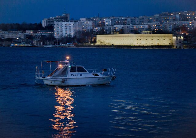 A pleasure boat with Sevastopol in the background