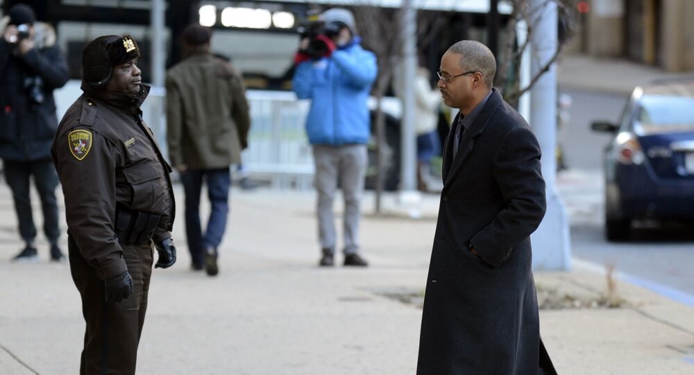 Caesar R. Goodson Jr., one of six Baltimore city police officers charged in connection to the death of Freddie Gray, arrives at a courthouse for jury selection in his trial, Monday, Jan. 11, 2016, in Baltimore Md