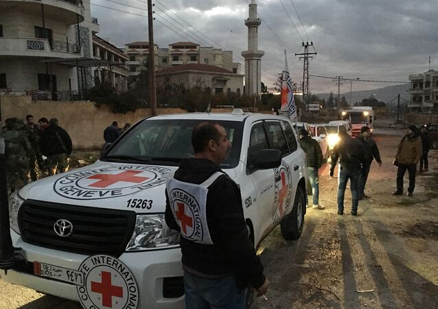 File Photo: This picture provided by The International Committee of the Red Cross (ICRC), working alongside the Syrian Arab Red Crescent (SARC) and the United Nations (UN), shows a convoy containing food, medical items, blankets and other materials being delivered to the town of Madaya in Syria, Monday, Jan. 11, 2016