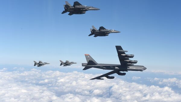 This picture taken by the Republic of Korea Air Force on January 10, 2016 and released via Yonhap news agency shows a US B-52 Stratofortress (bottom R) flying with South Korean F-15K fighter jets (top) and US F-16 fighter jets (bottom L) over South Korea - Sputnik International