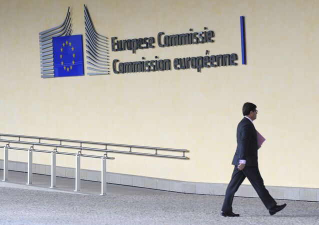 A man walks in front of the Charlemagne building at the European Union (EU) headquarters in Brussels on June 10, 2013