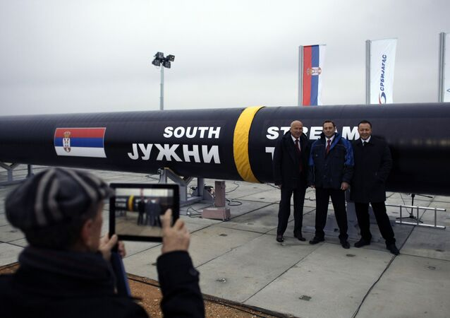People have their photo taken next to the first section of the Gazprom South Stream natural gas pipeline in the town of Sajkas, 80 kilometers (50 miles) north of Belgrade, Serbia, Sunday, Nov. 24, 2013