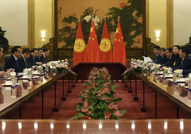 Kyrgyzstan's Prime Minister Temir Sariyev (2nd R) speaks during a meeting with Chinese Premier Li Keqiang (2nd L) in the Great Hall of the People in Beijing on December 16, 2015