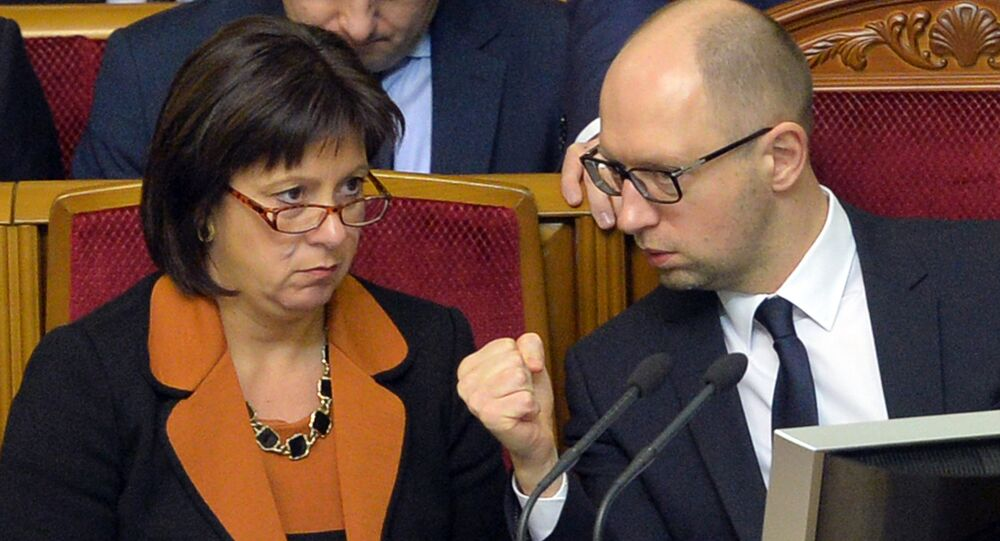 Ukrainian Prime Minister Arseniy Yatsenyuk (R) gestures as he speaks with Ukrainian Finance Minister Natalia Jaresko during a parliament session in Kiev on December 23, 2014
