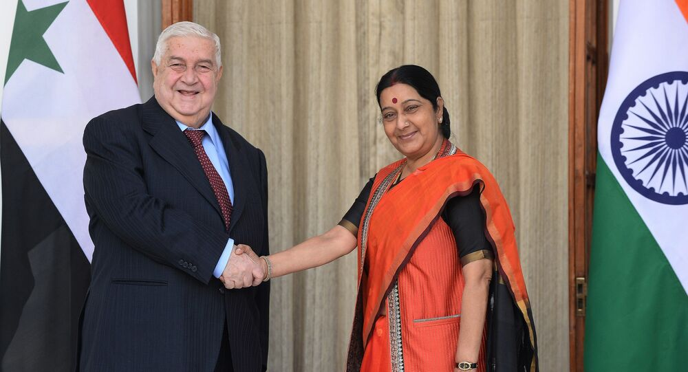 Indian Foreign Minister Sushma Swaraj (R) shakes hands with Syrian Foreign Minister, Walid Muallem prior to a meeting in New Delhi on January 12, 2016