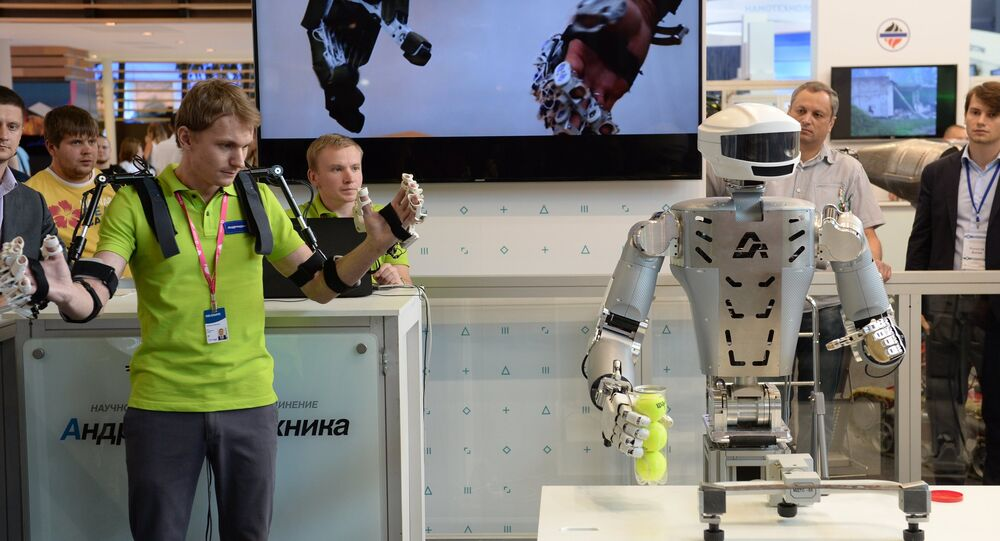An employee of Androidnaya Teknika demonstrates a robot's operation at the V Innoprom International Industrial Exhibition in Yekaterinburg. File photo