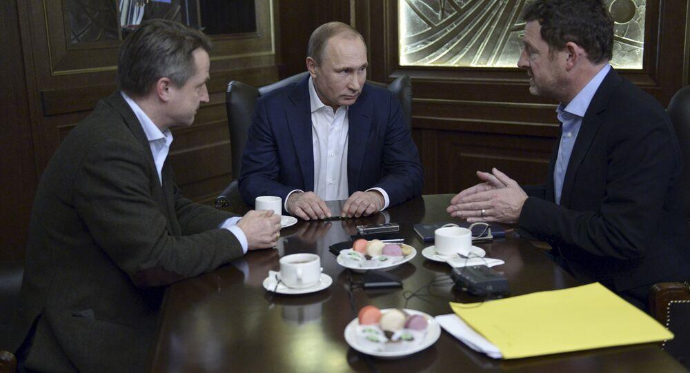 Russian President Vladimir Putin (C) gives an interview to Kai Diekmann (R), chief editor of Germany's Bild newspaper, and Nikolaus Blome, Bild deputy editor, at the Bocharov Ruchei state residence in Sochi, Russia, January 5, 2016