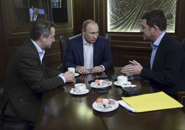 Russian President Vladimir Putin (C) gives an interview to Kai Diekmann (R), chief editor of Germany's Bild newspaper, and Nikolaus Blome, Bild deputy editor, at the Bocharov Ruchei state residence in Sochi, Russia, January 5, 2016
