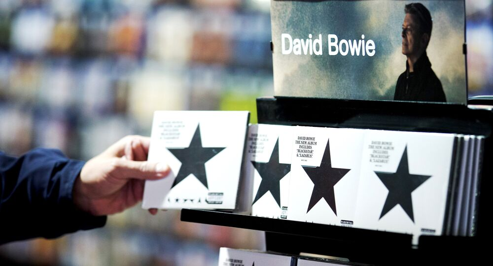 A customer picks up a copy of Blackstar the latest album by British musician David Bowie in a branch of HMV in central London on January 11, 2016.