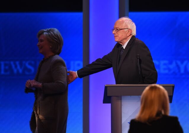 US Democratic presidential hopefuls Hillary Clinton and Bernie Sanders leave the stage during a break in the Democratic Presidential Debate hosted by ABC News at Saint Anselm College in Manchester, New Hampshire, on December 19, 2015