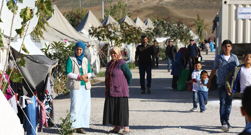 Syrian Refugees go about their daily lives at the refugee camp in Osmaniye on December 15, 2015