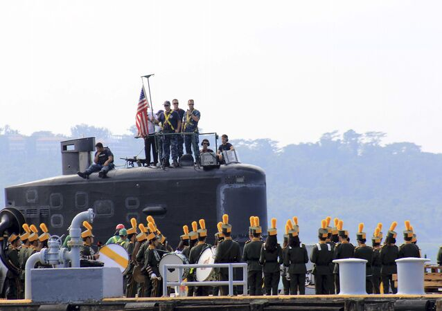 A local marching band welcomes the arrival of sailors aboard the USS Topeka (SSN-754), a Los Angeles-class submarine, as it prepares to be docked at the Alava pier off Subic port in Zambales province for a three-day port call at northwestern Philippines, Tuesday, Jan. 12, 2016