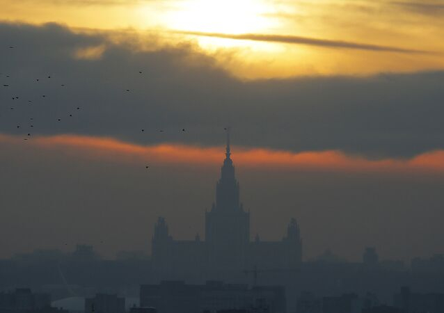 The sun sets over the Moscow State University on a frosty winter day in Moscow, Russia