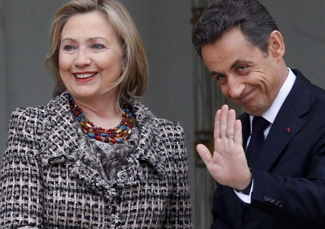 Then Secretary of State Hillary Clinton, left, is welcomed by then French President Nicolas Sarkozy before a crisis summit on Libya at the Elysee palace in Paris, Saturday, March, 19, 2011.
