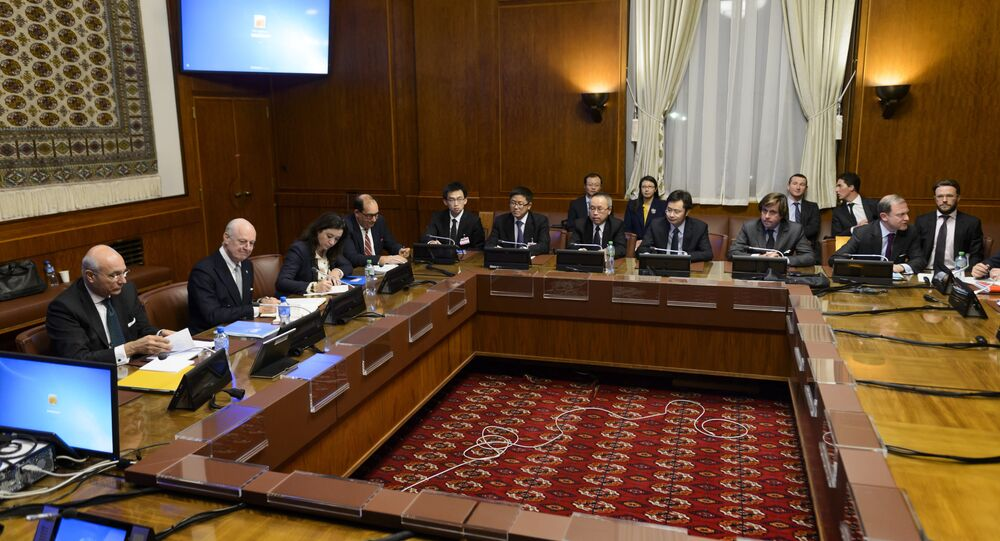 General view at the opening of a meeting between the United Nations Syria envoy Staffan de Mistura (2nd L) and ambassadors from the five permanent members of the UN Security Council on January 13, 2016 at the United Nations Office in Geneva
