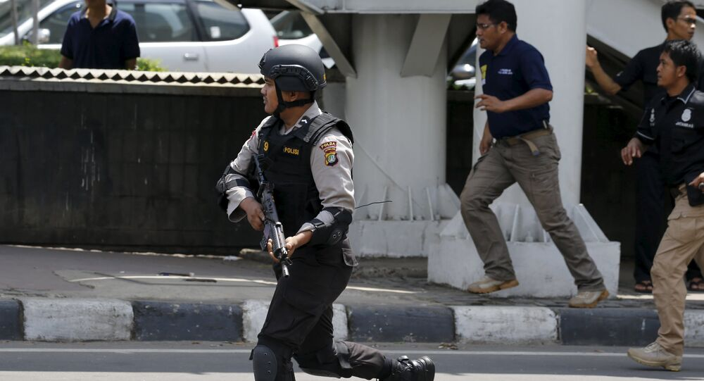 An Indonesian policeman runs near the site of a blast in Jakarta, Indonesia, January 14, 2016