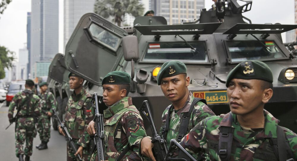 Indonesian soldiers stand guard near the site where an explosion went off in Jakarta, Indonesia Thursday, Jan. 14, 2016
