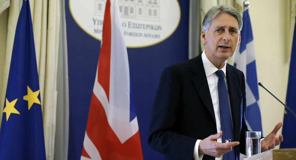 British Foreign Secretary Philip Hammond answers to a question during a news conference.