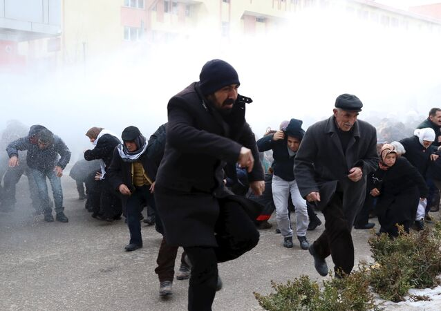 Riot police use water cannons to disperse pro-Kurdish demonstrators during a protest against security operations in the Kurdish-dominated southeast, in Van, Turkey