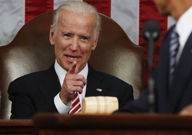 Vice President Joe Biden points at President Barack Obama during the State of the Union address to a joint session of Congress on Capitol Hill in Washington, Tuesday, Jan. 12, 2016.